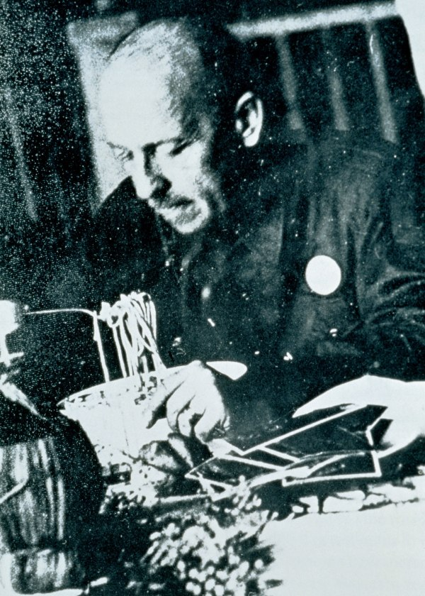 Marinetti eating pasta at Milan's Biffi restaurant, 1930, Courtesy Estorick Collection