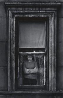 Charles Harbutt, Woman in Window, Yorkville New York, 1958.